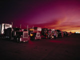 Vivid Sunset over Trucks Parked in a Truck Stop Near Sayre, Oklahoma Photographic Print by Scott Sroka