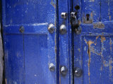 Detail of Weathered Blue Doors Fotografisk tryk af David Evans
