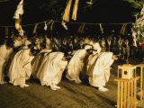 Shinto Priests Bow at the Kamiarizuku Festival Photographic Print by Martin Gray