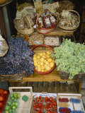 Fresh Fruit and Foods for Sale Outside a Siena Market Photographic Print by Gina Martin