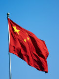Chinese Flag Flying in Front of the Pearl TV Tower Photographic Print by  xPacifica
