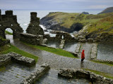 Tourist Walks the Paths of Tintagel Castle Overlooking the Coast Photographic Print by Jim Richardson