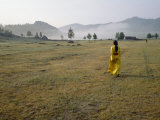 Female Shaman Walks across Grass in a Bright Yellow Silk Robe Fotografisk tryk af  xPacifica