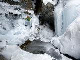 Man Climbs in an Ice Cave Photographic Print by Dawn Kish