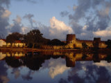 Village of Kizingitini Is Reflected in the Water Photographic Print by Michael S. Yamashita