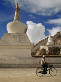 Man on a Bicycle Passes a Buddhist Stupa Outside the Potala Palace Photographic Print by  xPacifica