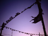 Prayer Flags Against a Lavender Sky at Dusk Photographic Print by Lynn Johnson