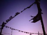 Prayer Flags Against a Lavender Sky at Dusk Photographic Print by Lynn Johnson