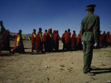 Pla Soldier Watches Buddhist Monks in Robes at a Horse Festival Photographic Print by  xPacifica