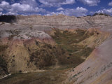 Colorful Hills under a Cloudy Sky in the Western Badlands Photographic Print by Paul Damien