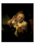Young Woman Trying Earrings, 1654 Print by  Rembrandt van Rijn