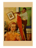 Wife Sews While a Man Hangs a Picture Posters