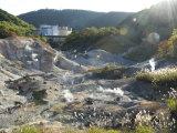 Steam Vents in Jigokudani Geothermal Area, Hotels of Noboribetsu Onsen Beyond, Hokkaido, Japan Photographic Print by Tony Waltham