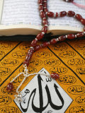 Koran, Rosary and Allah Calligraphy, Paris, France, Europe Photographic Print by  Godong