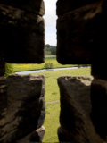 River Aln Seen Through Arrow Slit of Walls of Alnwick Castle, Northumberland, England Photographic Print by Nick Servian