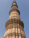 Qutb Minar, Victory Tower Built Between 1193 and 1368 of Sandstone, 73M High, Delhi, India Photographic Print by Tony Waltham