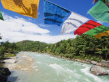Prayer Flags on a Bridge, Bumthang, Chokor Valley, Bhutan, Asia Photographic Print by Christian Kober
