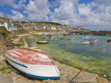 Small Unturned Boat on Quay and Small Boats in Enclosed Harbour at Mousehole, Cornwall, England Photographic Print by Neale Clark
