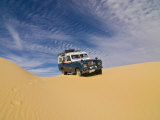 Jeep Driving Through the High Sand Dune of Western Desert, Near Siwa, Egypt, North Africa, Africa Photographic Print by Michael Runkel