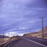 Empty Road with Power Poles on Both Sides, Eastern Washington State, United States of America Photographic Print by Aaron McCoy