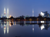 Petronas Towers and Istana Budaya National Theatre, Lake Titiwangsa, Kuala Lumpur, Malaysia, Asia Photographic Print by Christian Kober