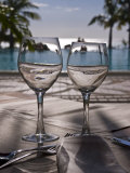 Wine Glasses in Front of the Pool of the Beachcomber Le Paradis, Mauritius, Indian Ocean, Africa Photographic Print by Michael Runkel