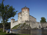 Girls Relaxing Beside Olavinlinna Medieval Castle (St. Olaf's Castle), Finland, Scandinavia Photographic Print