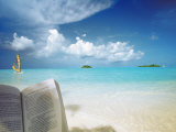 Reading Book on the Beach, Windsurfing and Islands in the Distance, the Maldives, Indian Ocean Photographic Print by Sakis Papadopoulos