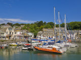 Busy Tourist Shops, Small Boats and Yachts at High Tide in Padstow Harbour, North Cornwall, England Photographic Print by Neale Clark