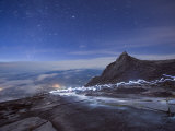 Stars and Torch Lights Illuminating Hiking Trail, Kinabalu National Park, Sabah, Malaysia, Asia Photographic Print by Christian Kober