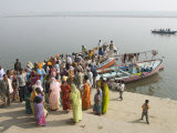 Boat on the River Ganges While a Cremation Takes Place, Varanasi, Uttar Pradesh State, India Photographic Print by Tony Waltham