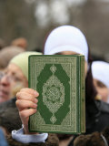 Koran Being Held During a Muslim Demonstration, Paris, France, Europe Photographic Print by  Godong