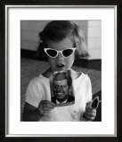 Caroline Kennedy holds a Postcard of her Father, 1961 Prints by Stanley Tretick