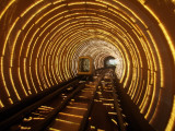 Empty Tourist Subway Car Runs Through Illuminated Tunnel in Shanghai, China Photographic Print