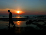 Buddhist Monk Walks Along the Beach During Sunset in Khoa Lak, Thailand Photographic Print