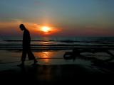 Buddhist Monk Walks Along the Beach During Sunset in Khoa Lak, Thailand Photographic Print