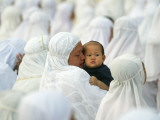 Acehnese Woman Holds a Child after Eid Al-Adha Prayer in the Tsunami-Ravaged Town of Meulaboh Photographic Print