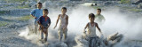 Dust Rises, as Children Play in an Open Field at Phulpur Village, India Photographic Print