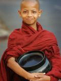 Young Myanmar Buddhist Monk Smiles Broadly as He Waits for Donations Early on a Yangon Street Photographic Print