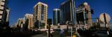 Traffic Light and Skyscrapers, Sheikh Rashid Bin Saeed Al Maktoum Street, Abu Dhabi, U.A.E. Photographic Print by  Panoramic Images
