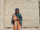 Young Girl in Front of a Mud Home in the Village of Tarale, Afghanistan Photographic Print