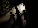 Ultra-Orthodox Jewish Children Walk in a Street in the Mea Shearim Neighborhood in Jerusalem Photographic Print