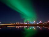 Aurora Borealis over a Town, Njardvik, Iceland Photographic Print
