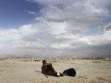 Man and His Wife, Lying on the Ground, Asks for Alms in Kabul, Afghanistan Photographic Print