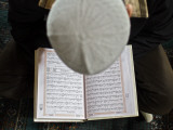 Kyrgyz Man Reads the Koran During a Friday Prayer Inside a Mosque in Osh, Southern Kyrgyzstan Photographic Print