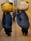 Afghan Women Clad in Burqas Carry Second Hand Clothes to Wash before Trying to Sell Them Photographic Print
