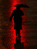 Man Walks Through the Rain in the Financial District in New York Photographic Print