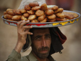 Pakistani Food Vender Displays Food as He Waiting for Customer in Islamabad, Pakistan Photographic Print
