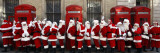 Men from the London Santa School, Dressed in Christmas Outfits, Pose by Telephone Boxes in London Photographic Print