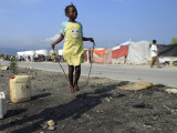 Youth Jumps Rope in a Camp for People Displaced by the Earthquake in Port-Au-Prince Photographic Print